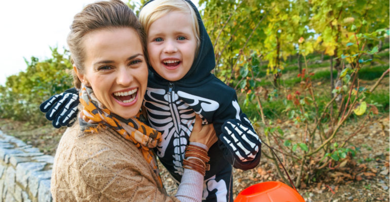 mom and toddler trick or treating