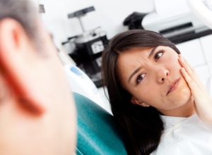 women at dentist for root canal