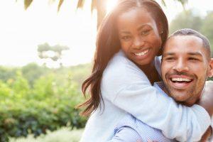 smiling couple   dental implants