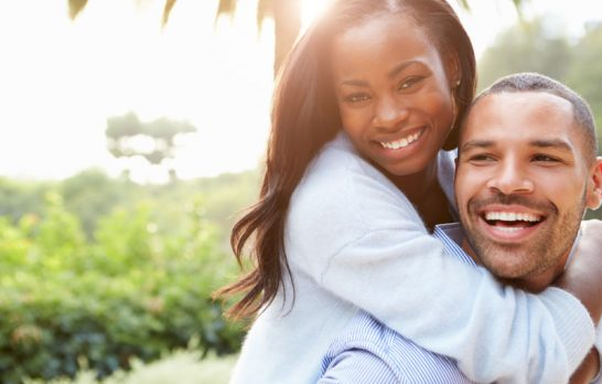 smiling couple | dental implants