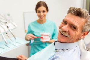 Patient with hygienist discussing gum disease