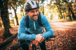 Plaque | Man on bicycle smiling