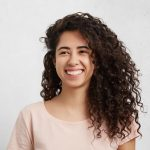 Local Cosmetic Dentist | Woman smiling.