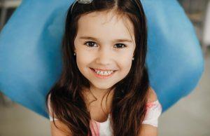 pediatric dentist   Little girl smiling at camera.
