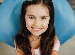 pediatric dentist | Little girl smiling at camera.