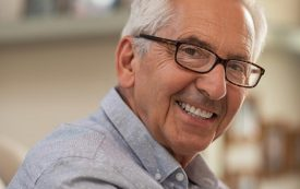 cosmetic dentistry | happy elderly man.