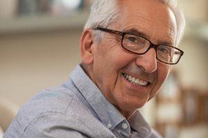 cosmetic dentistry   happy elderly man.