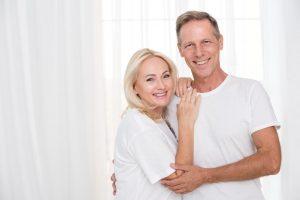 Dental Bridges | Older couple smiling.