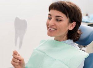 Dental Fillings | Dental patient looking at mirror