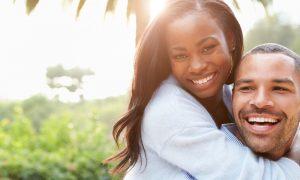 Gingivitis | Happy couple smiling.